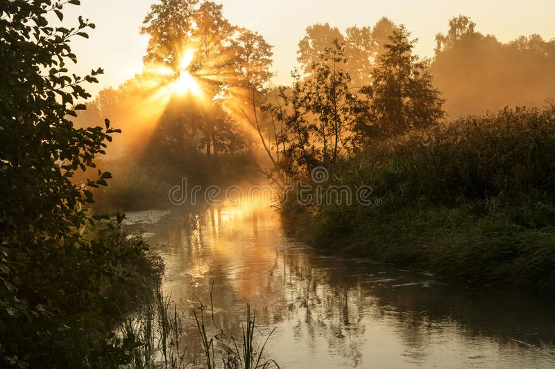 Fog over the river with the rising sun. Horizontal stock image