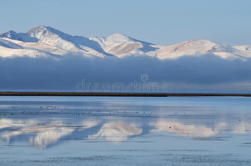 Fog over Son-Kul mountain lake early in the morning,central Tien Shan.Name translation is `the last lake`, Kyrgyzstan,Central Asi stock photo