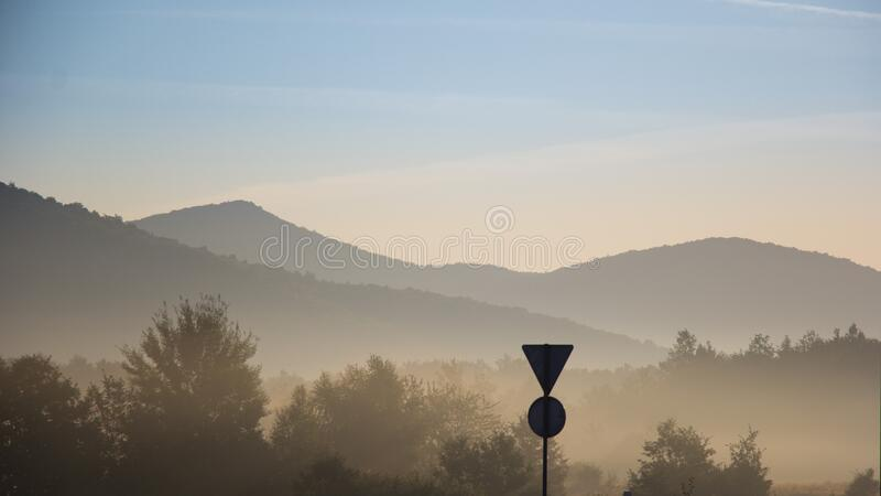 Fog over valley at sunset stock photo