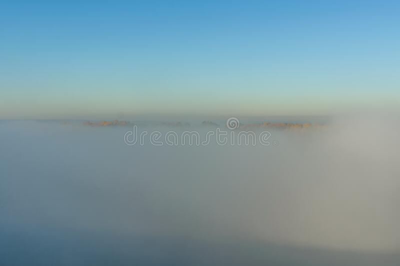 Fog over the water on a river Dnieper on autumn. Fog over the water on river Dnieper on autumn stock photography