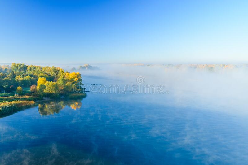 Fog over the water on a river Dnieper on autumn. Fog over the water on river Dnieper on autumn stock photos