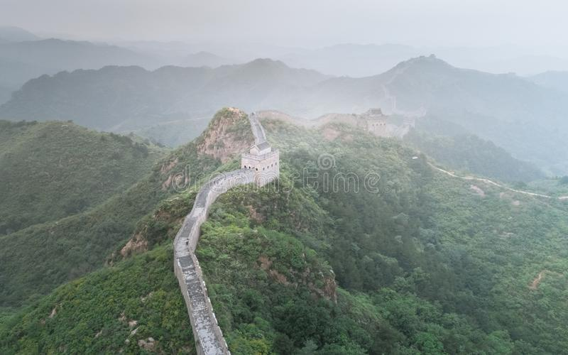 Fog painted scenery of Great Wall, Morning,China-East Asia. The Great Wall,the most representative part of the Chinese brick-made dragon, has been stock image