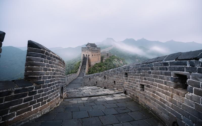 Fog painted scenery of Great Wall,China-East Asia. The Great Wall,the most representative part of the Chinese brick-made dragon, has been rebuilt stock images