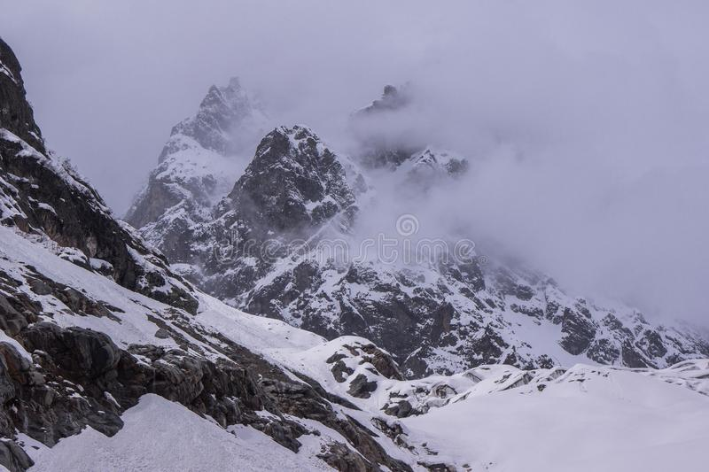 Fog rising over mountain in Chalaadi Glacier royalty free stock images