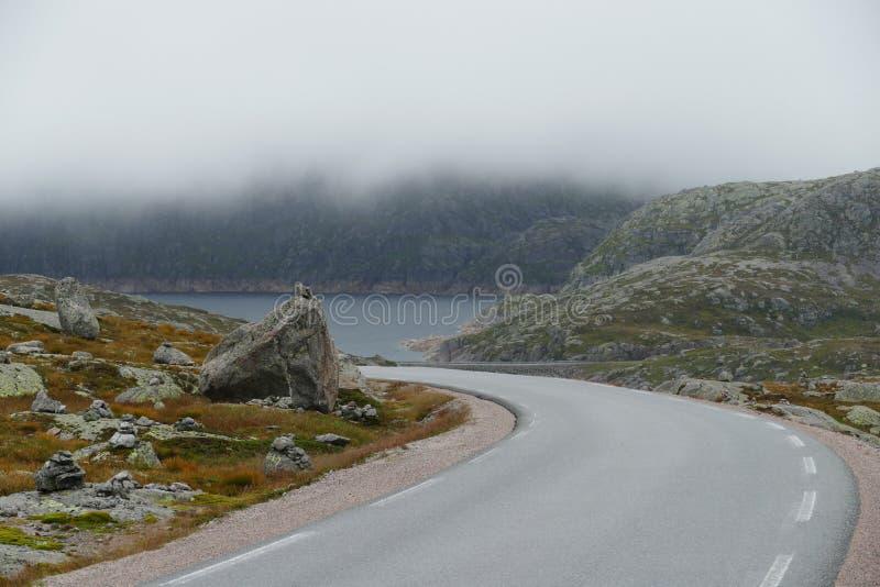 Fog road mountains stock photo