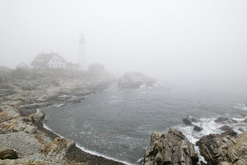 Fog shrouds the Portland Head Lighthouse in Cape Elizabeth, Maine stock photos