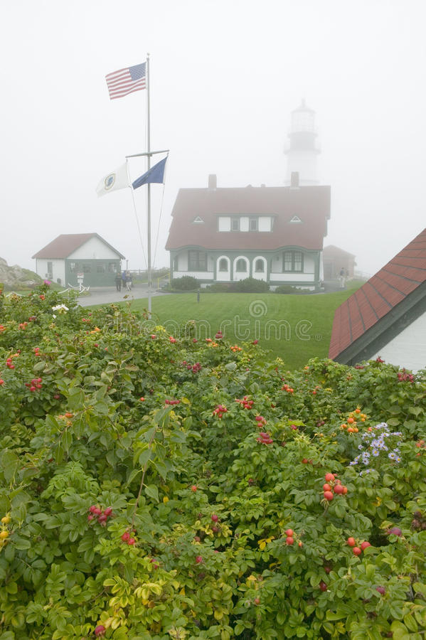 Fog shrouds the Portland Head Lighthouse in Cape Elizabeth, Maine stock photography