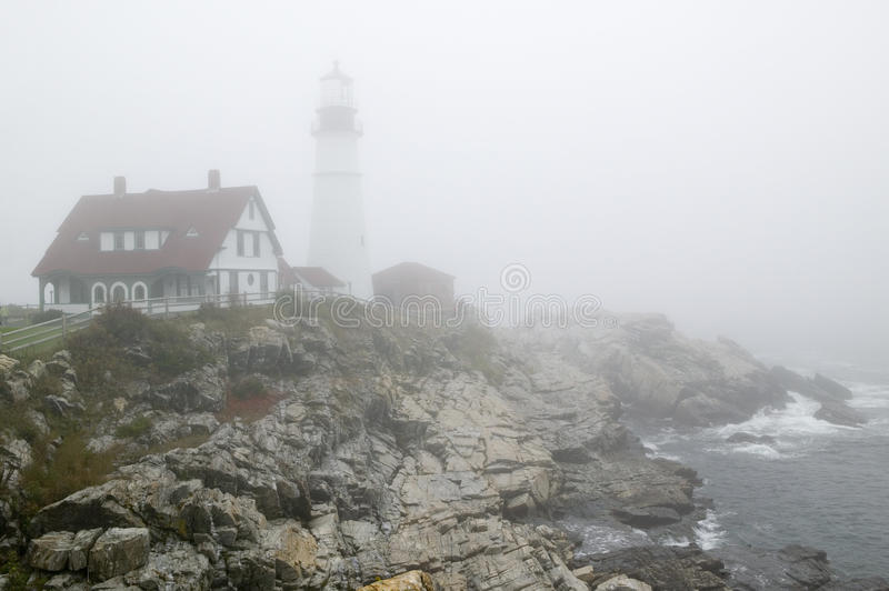 Fog shrouds the Portland Head Lighthouse in Cape Elizabeth, Maine stock image