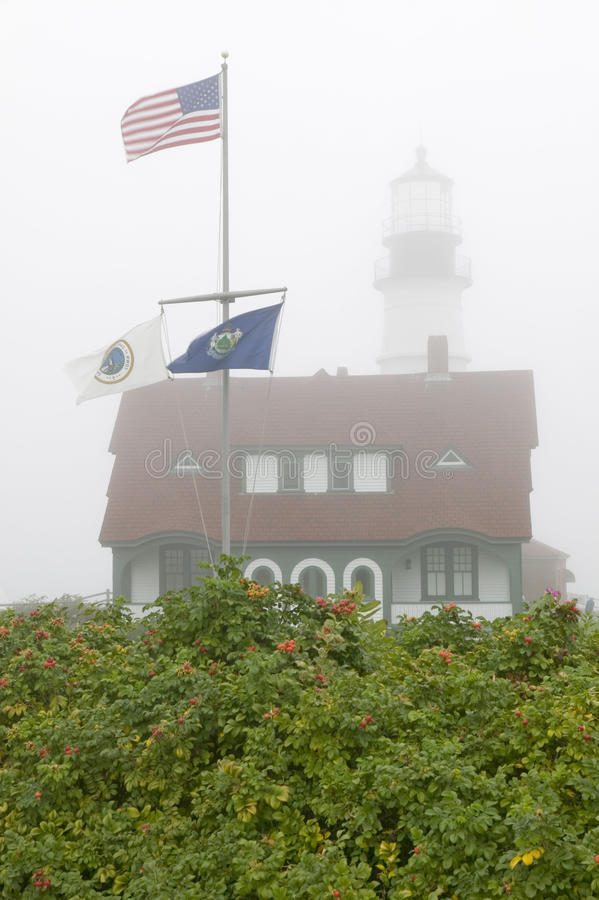 Fog shrouds the Portland Head Lighthouse in Cape Elizabeth, Maine royalty free stock image