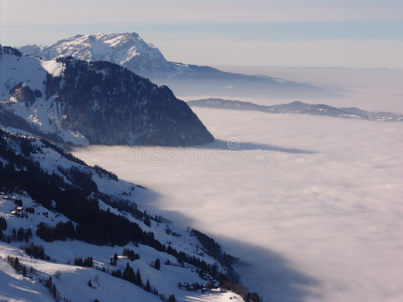 Fog and Swiss Mountains in Winter stock photography