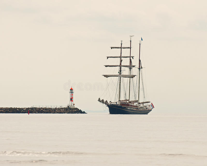 In the fog three masted in to a pier stock photography