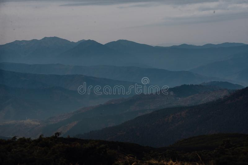 Fog on top of a mountain range royalty free stock photo