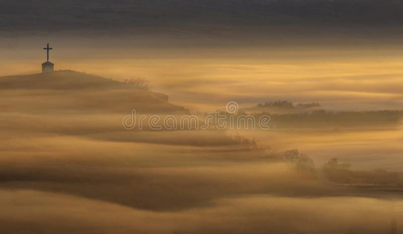 Fog and cross at early morning stock photos
