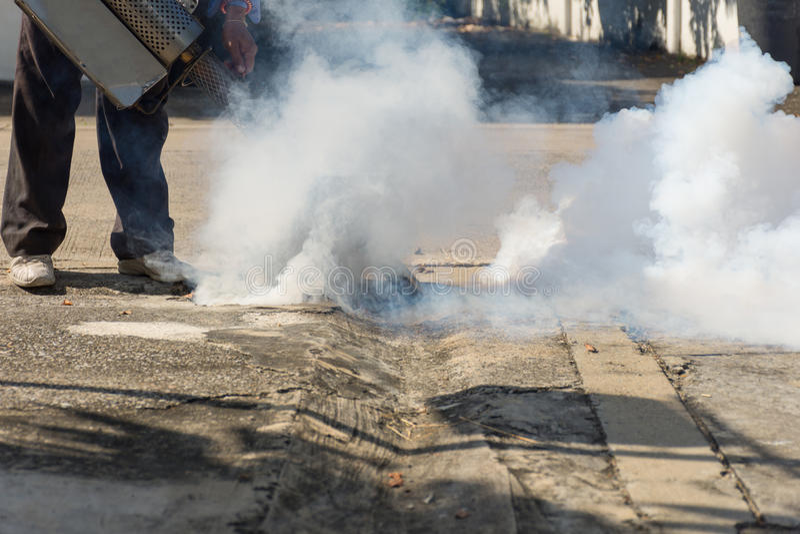 Fogging DDT spray kill mosquito. People fogging DDT spray kill mosquito for control Malaria, Encephalitis, Dengue and Zika in village at Bangkok Thailand stock photography