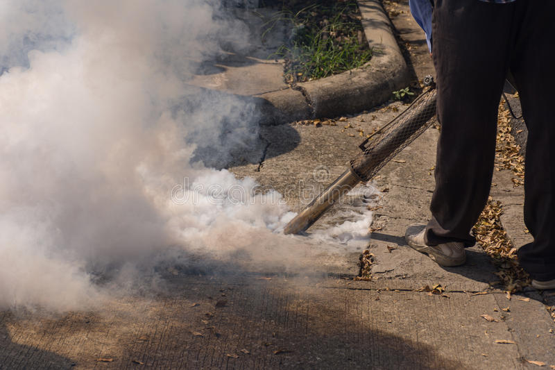 Fogging DDT spray kill mosquito. People fogging DDT spray kill mosquito for control Malaria, Encephalitis, Dengue and Zika in village at Bangkok Thailand royalty free stock image