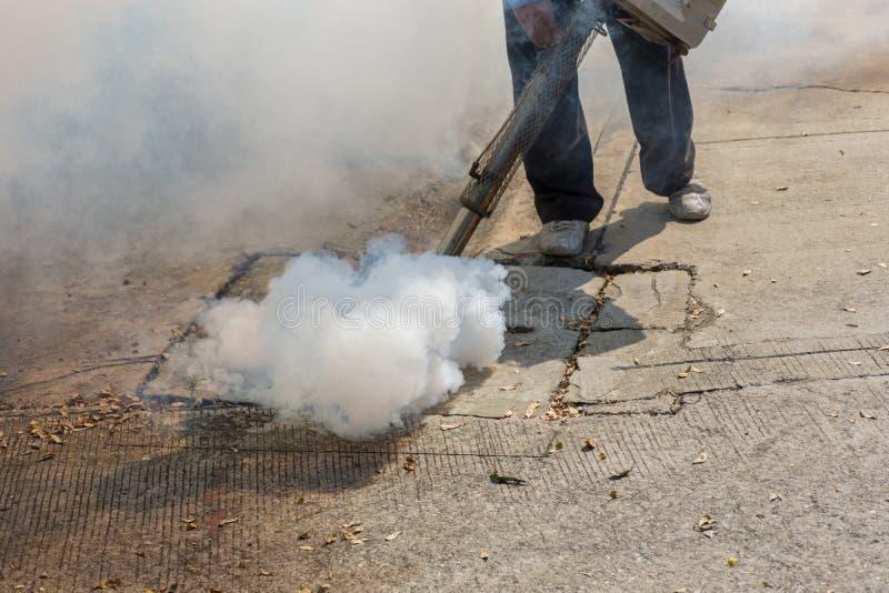 Fogging DDT spray kill mosquito. People fogging DDT spray kill mosquito for control Malaria, Encephalitis, Dengue and Zika in village at Bangkok Thailand royalty free stock photography