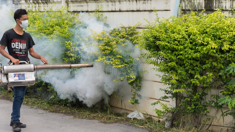 Fogging DDT spray mosquito kill for virus protect. Bangkok, Thailand - July 3, 2016 : Unidentified people fogging DDT spray for mosquito kill and protect by stock images