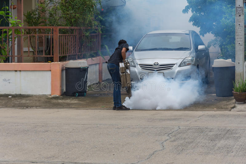 Fogging DDT spray mosquito kill for virus protect. Bangkok, Thailand - July 3, 2016 : Unidentified people fogging DDT spray for mosquito kill and protect by royalty free stock images