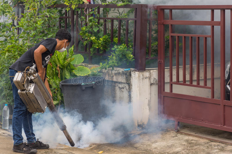 Fogging DDT spray mosquito kill for virus protect. Bangkok, Thailand - July 3, 2016 : Unidentified people fogging DDT spray for mosquito kill and protect by stock image