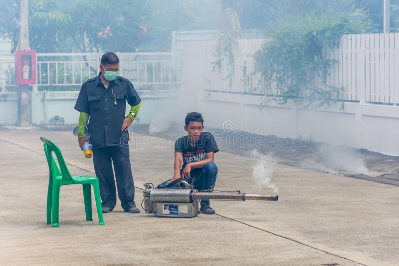 Fogging DDT spray mosquito kill for virus protect. Bangkok, Thailand - July 3, 2016 : Unidentified people fogging DDT spray for mosquito kill and protect by royalty free stock photography
