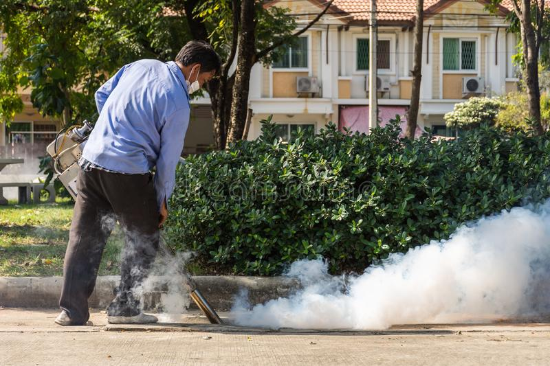 Fogging DDT spray mosquito kill for virus protect. Bangkok, Thailand - November 19, 2016 : Unidentified people fogging DDT spray for mosquito kill and protect by stock image