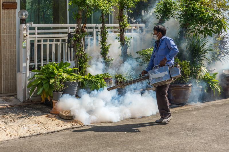 Fogging DDT spray mosquito kill for virus protect. Bangkok, Thailand - November 19, 2016 : Unidentified people fogging DDT spray for mosquito kill and protect by stock images