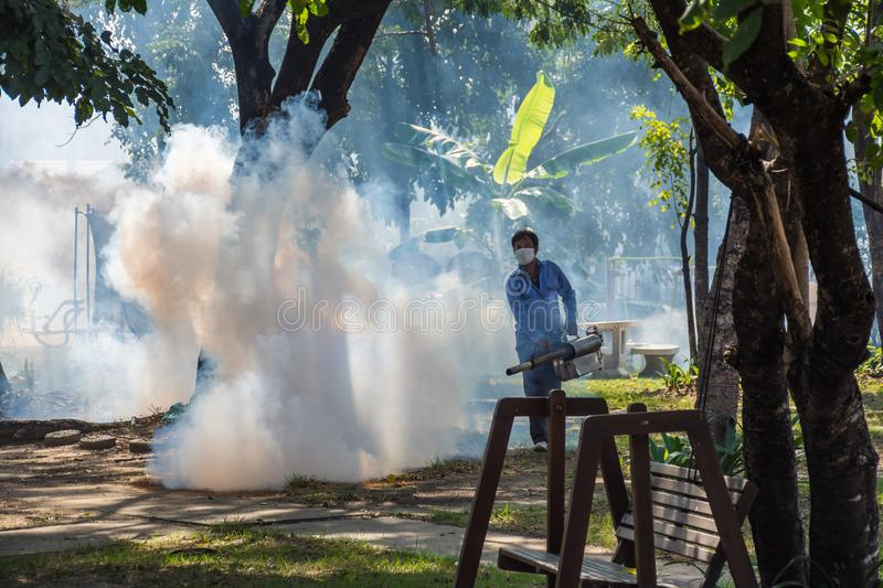 Fogging DDT spray mosquito kill for virus protect. People fogging DDT spray for mosquito kill and protect by control mosquito is a carrier of Malaria stock image