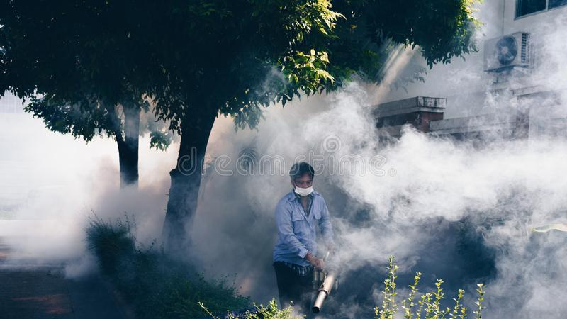 Fogging DDT spray mosquito kill for virus protect. People fogging DDT spray for mosquito kill and protect by control mosquito is a carrier of Malaria royalty free stock photography