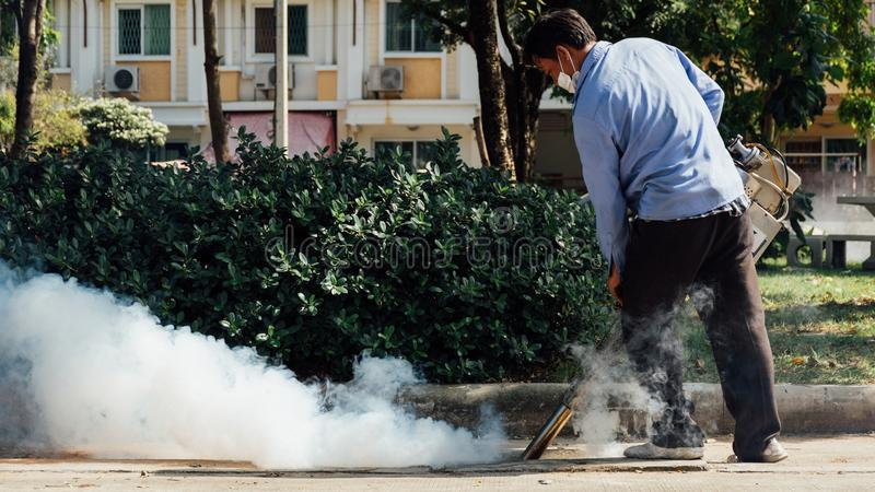 Fogging DDT spray mosquito kill for virus protect. People fogging DDT spray for mosquito kill and protect by control mosquito is a carrier of Malaria stock images