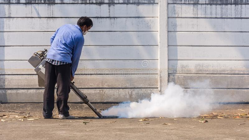 Fogging DDT spray mosquito kill for virus protect. People fogging DDT spray for mosquito kill and protect by control mosquito is a carrier of Malaria stock photography