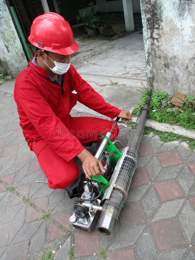 Fogging. Health officials are conducting fogging to eradicate mosquitoes in the city of Solo, Central Java, Indonesia royalty free stock photos
