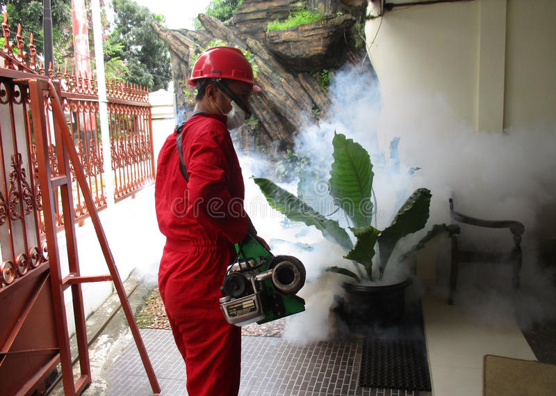 Fogging. Health officials are conducting fogging to eradicate mosquitoes in the city of Solo, Central Java, Indonesia stock photography