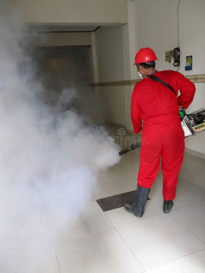 Fogging. Health officials are conducting fogging to eradicate mosquitoes in the city of Solo, Central Java, Indonesia royalty free stock photo