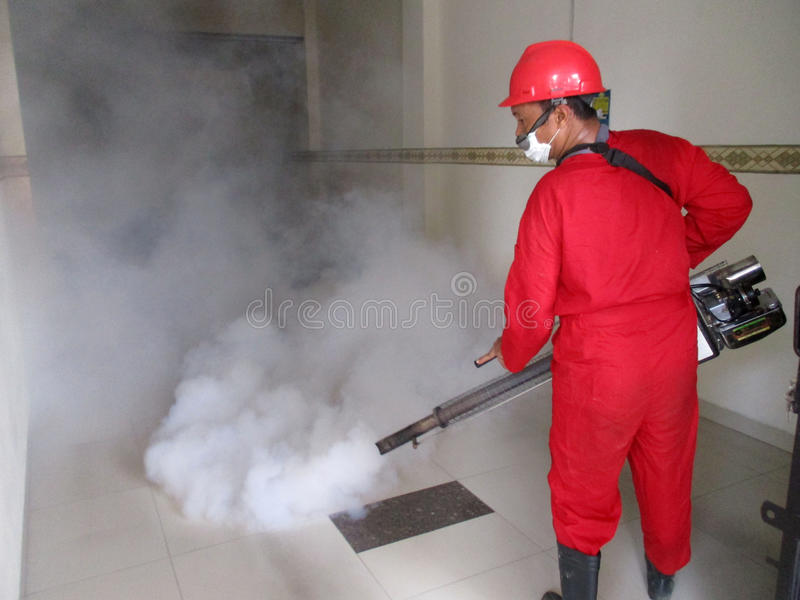 Fogging. Health officials are conducting fogging to eradicate mosquitoes in the city of Solo, Central Java, Indonesia stock image
