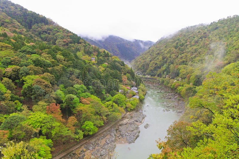 Foggy afternoon at Hozugawa River at Arashiyama park in Kyoto, J. Foggy afternoon at Hozugawa River. Photo taken from the Summit Observation Deck, Arashiyama royalty free stock images