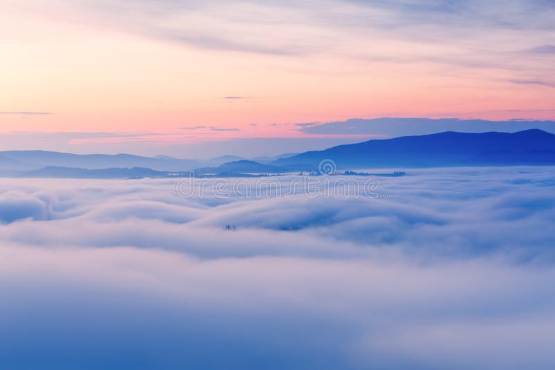 Foggy autumn landscape. Colorful fog and mountains on morning sky background. Tatras, Poland royalty free stock image
