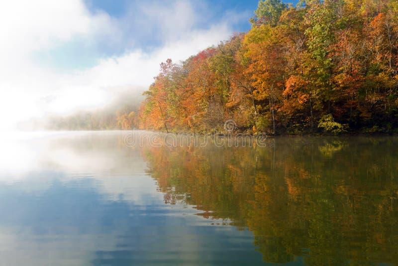 Foggy autumn morning on Missouri lake stock photo