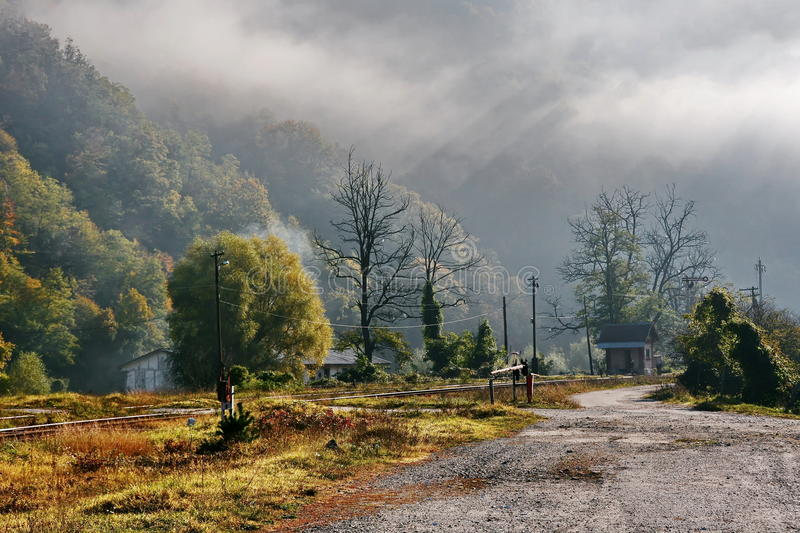 Foggy Autumn Morning in Romania. Foggy autumn morning with old railway and forest in Romania royalty free stock photo