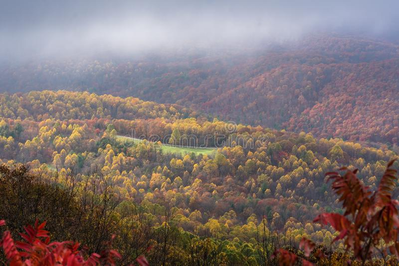 Foggy autumn view from Ravens Roost Overlook, on the Blue Ridge Parkway in Virginia stock photography