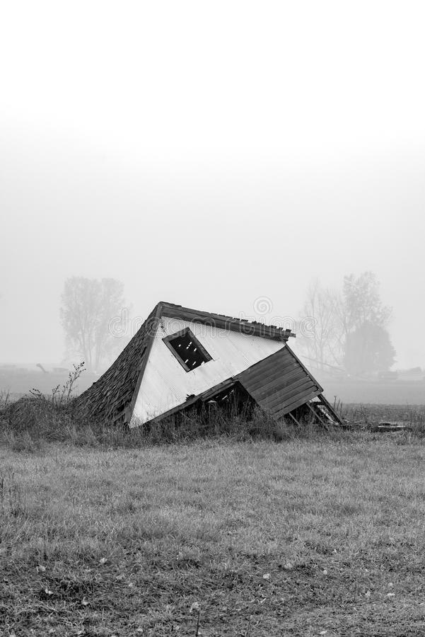 Foggy barn ruins stock photography