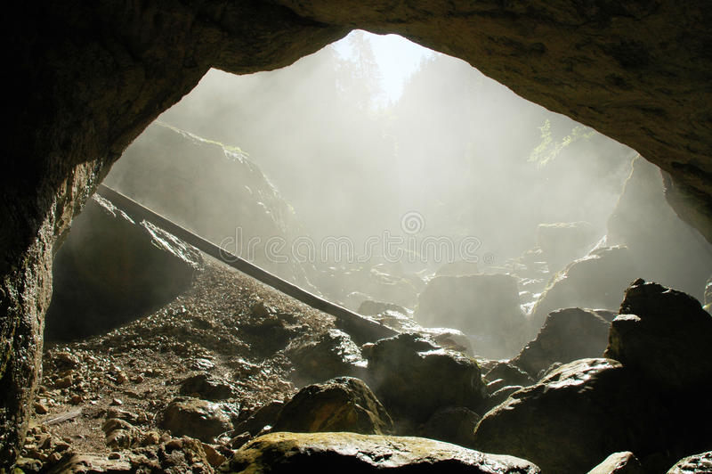Foggy cave entrance, Romania stock images