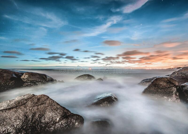Foggy coastline at sunrise stock photo
