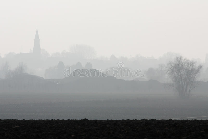 Foggy Countryside And Village Stock Photo