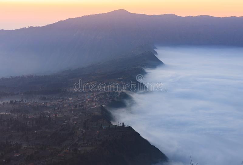 Foggy morning shot of the area surrounding Gunung Bromo, Java, Indonesia. Foggy dawn shot of the area surrounding Gunung Bromo, Java, Indonesia royalty free stock images
