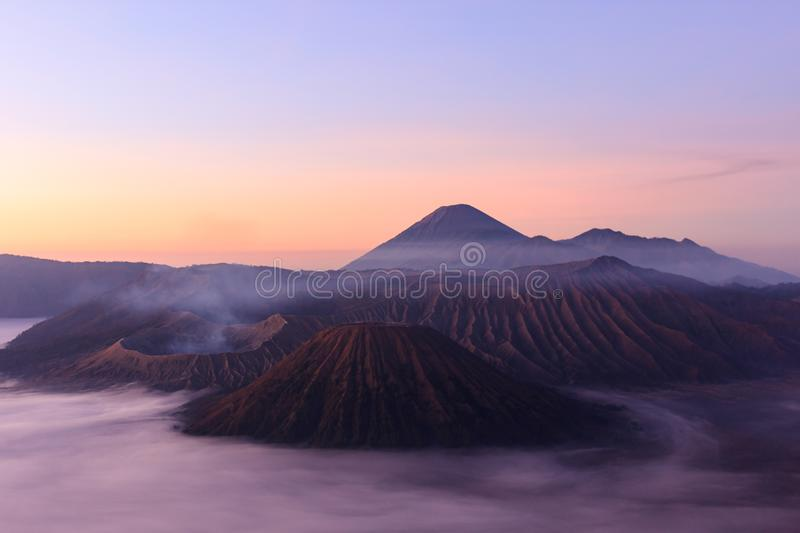 Morning shot of Gunung Bromo, Java, Indonesia. Foggy dawn shot of Gunung Bromo, or Mt Bromo, located on Java, Indonesia stock image