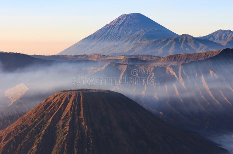 Morning shot of Gunung Bromo, Java, Indonesia. Foggy dawn shot of Gunung Bromo, or Mt Bromo, located on Java, Indonesia stock photos