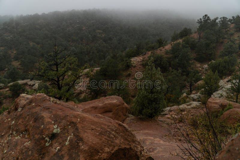 Colorado springs garden of the gods rocky mountains adventure travel photography. Foggy day morning fog in the garden of the gods in colorado springs - travel stock photos