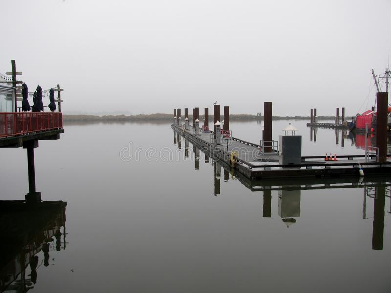 Fog on South Arm of the Fraser River. Steveston Village, Richmond, BC, Canada stock photography