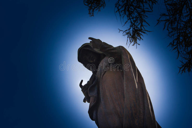 Foggy Graveyard at night. Old Spooky cemetery in moonlight through the trees royalty free stock image
