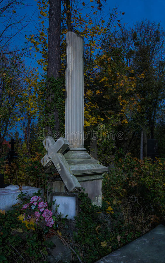 Foggy Graveyard at night. Old Spooky cemetery in moonlight through the trees stock photo